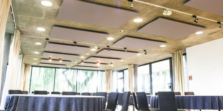 Acoustic panels suspended from the ceiling in a museum